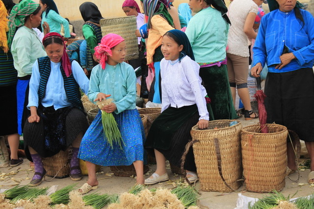 Happy smile of local girls going to the market